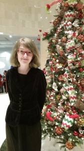 Grace standing next to one of the lovely Christmas trees in the theater lobby. :)